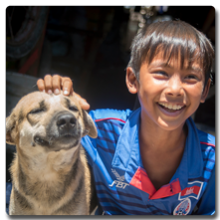 Cambodian boy with his dog